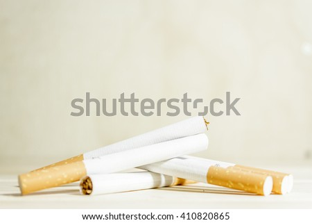 A bunch of cigarettes in a creamy background - stock photo