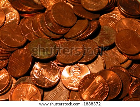 A bunch of copper pennies some shiny, some not so shiny in a pile. - stock photo