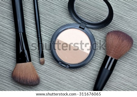 A bunch of cosmetics, Set of makeup brush and contour palette, Women accessories. - stock photo