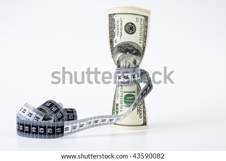 a bunch of dollar bills tighten by a measuring tape on white background