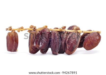a bunch of dried dates on a white background