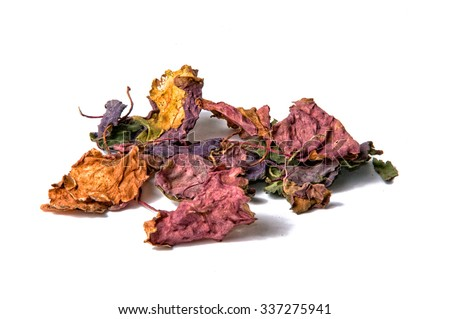 A bunch of dried multicolored patchouli leaves over white, not isolated.