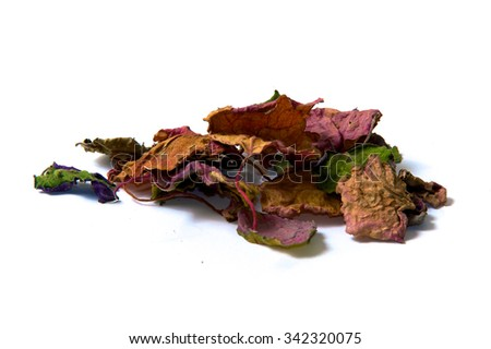 A bunch of dried multicolored patchouli leaves over white, not isolated. - stock photo
