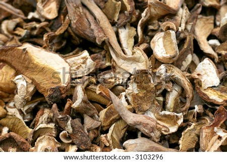 A bunch of dry mushrooms on the market - stock photo