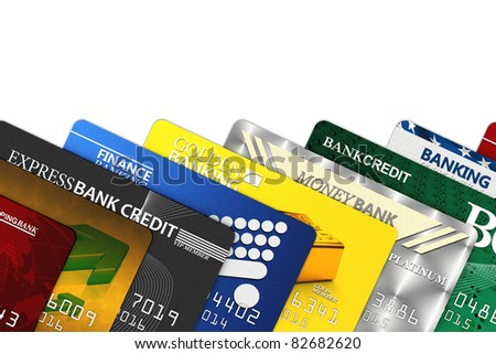 A bunch of fake credit cards over white with clipping path - all logos, names, number and designs are fake - stock photo