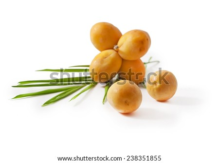 A bunch of fresh date fruits with palm leaf isolated on white background  - stock photo