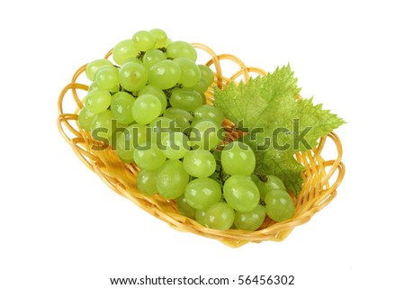a bunch of fresh grape in the basket isolated on white - stock photo