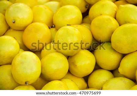 A bunch of fresh lemons in market