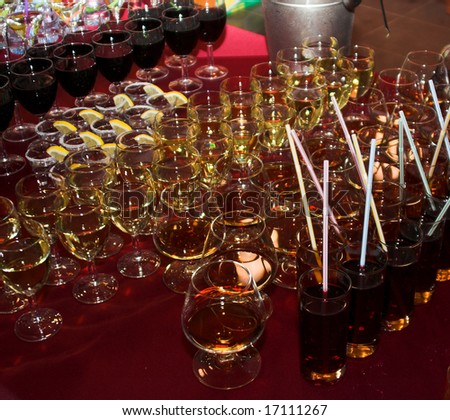 A bunch of glasses with beverages. Close-up shot. - stock photo