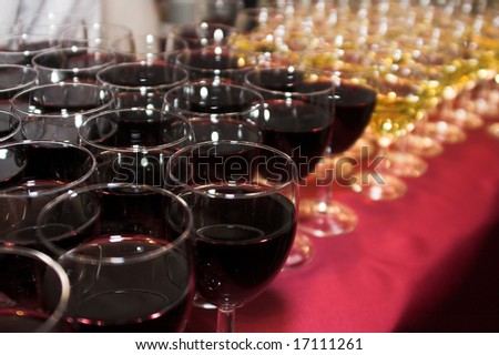 A bunch of glasses with wine in restaurant - stock photo