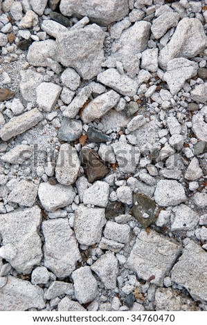 A bunch of gray smashed and crushed rock. - stock photo