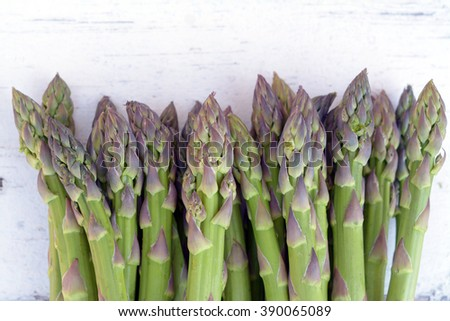 a bunch of green asparagus on the table - stock photo