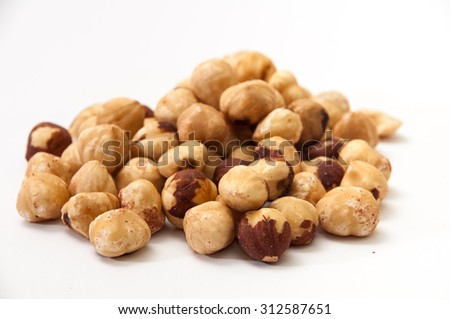 A bunch of hazelnuts on a white background. Raw hazelnuts isolated over white background. - stock photo
