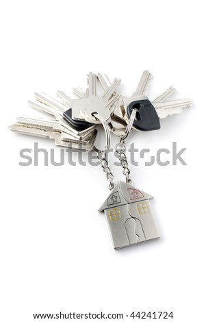 A bunch of keys with keychain isolated on white background. - stock photo
