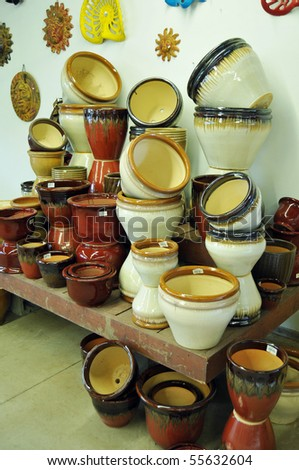 A bunch of large ceramic glazed pots made out of clay. - stock photo
