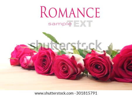 A bunch of mixed colors roses over wooden white background