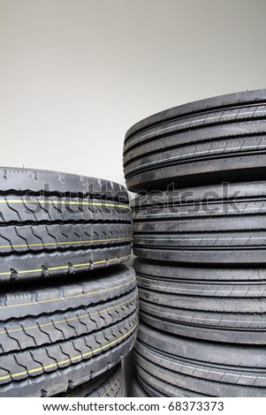 a bunch of new tires with the wall - stock photo