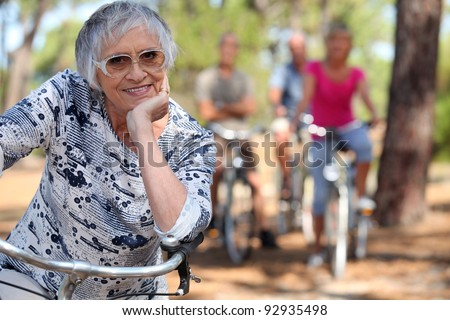 A bunch of old lady biking. - stock photo