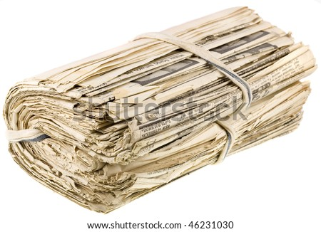 a bunch of old newspapers  isolated over white background - stock photo