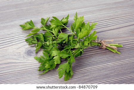 A bunch of parsley on wooden background