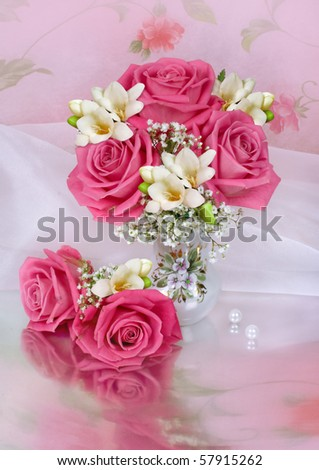 A bunch of pink roses in a glass vase - stock photo