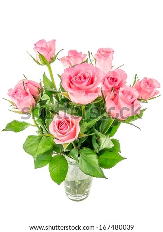 A bunch of pink roses in a glass vase on white background
