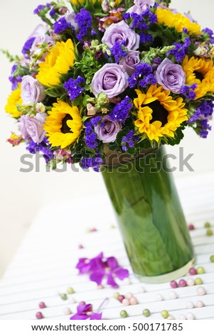 A bunch of purple roses and sunflowers - flower design, flower decoration - a special gift for women's day