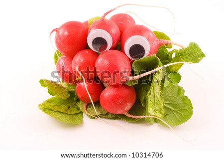 A bunch of radishes with a set of googly eyes sits on a white background. - stock photo