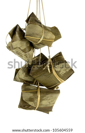 A bunch of Rice Dumplings hanging isolated on white - stock photo