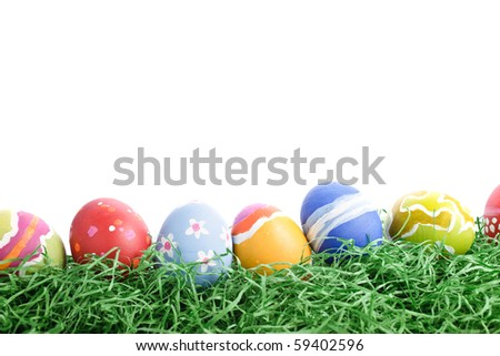 A bunch of rough stroked easter eggs in a row. In front of white background. - stock photo