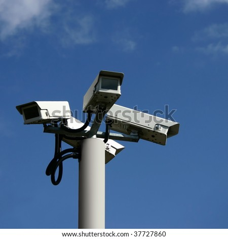 A Bunch of Security Cameras with Blue Sky - stock photo