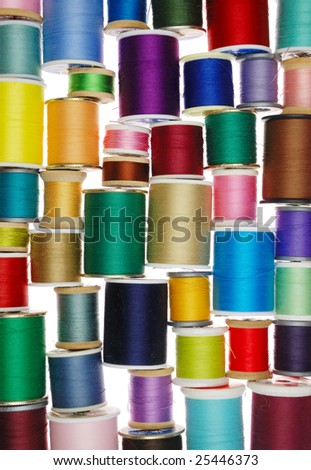 a bunch of spools of colored thread - stock photo