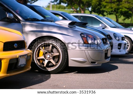 A bunch of Subaru Imprezas parked side by side - stock photo