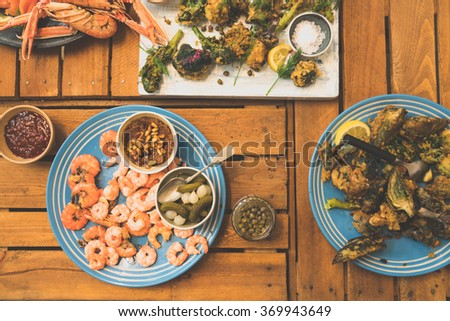 A bunch of tempura vegetables and prawns. - stock photo