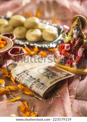 A bunch of thousand rupees indian note in Diwali Puja set up. - stock photo