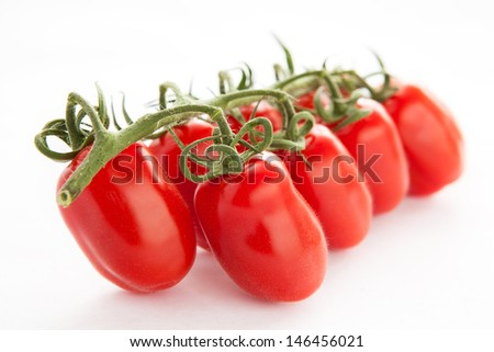 a bunch of tomatoes on a white background