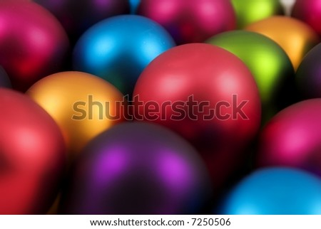 A bunch of very brightly colored christmas ornaments