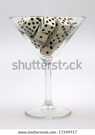 A bunch of white dice in a martini glass - stock photo