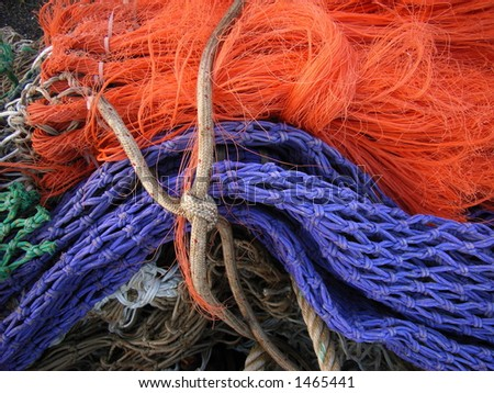 a bundle of colorful fishing nets - stock photo