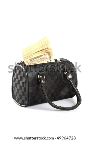 A bundle of currency in a ladies bag - stock photo