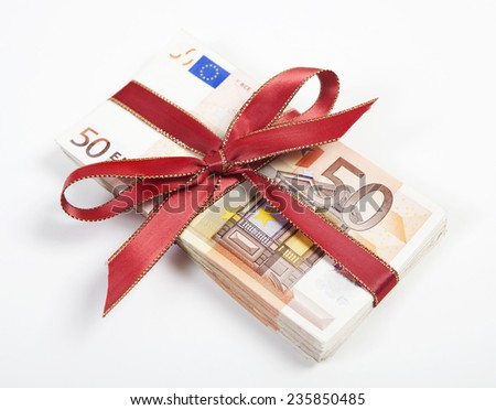 a bundle of euro bills wrapped with a red ribbon. white background - stock photo