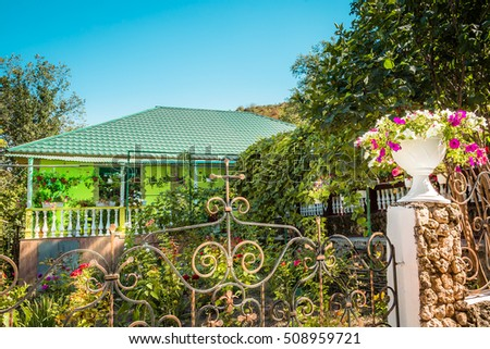 A bungalow in an area with rich vegetation and flowers in a village in Eastern Europe (Republic of Moldova)