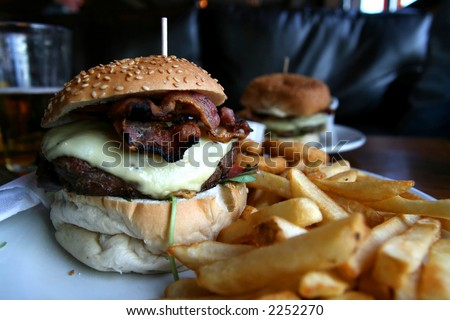 A burger with fries, as served in a British pub - stock photo