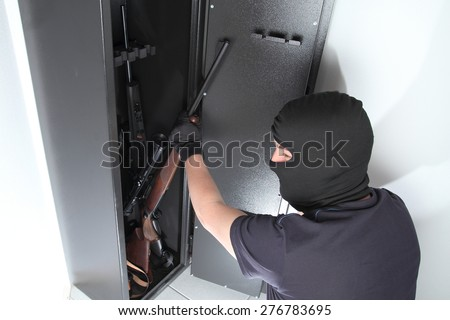 A Burglary and theft on Guns in a gun safe - stock photo