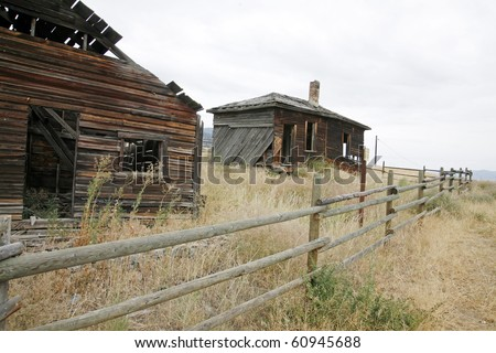 A burn down wooden house ih desert city osooyos. - stock photo
