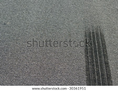 A burned rubber tire track on an asphalt road. - stock photo