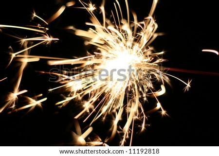 a burning sparkler at night