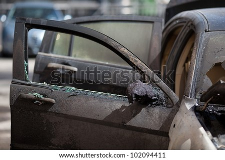 A burnt car - stock photo