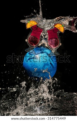 A burst balloon filled with water. - stock photo
