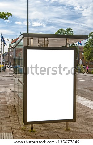 A bus stop in the Swedish town of Halmstad with blank billboard for your advertising needs. - stock photo
